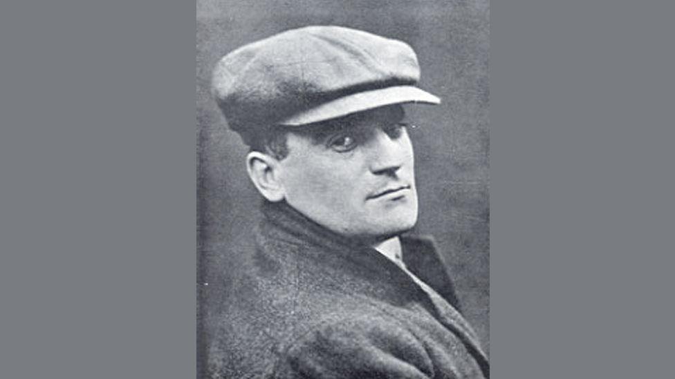 A portrait picture of Hugh Blaker wearing a hat