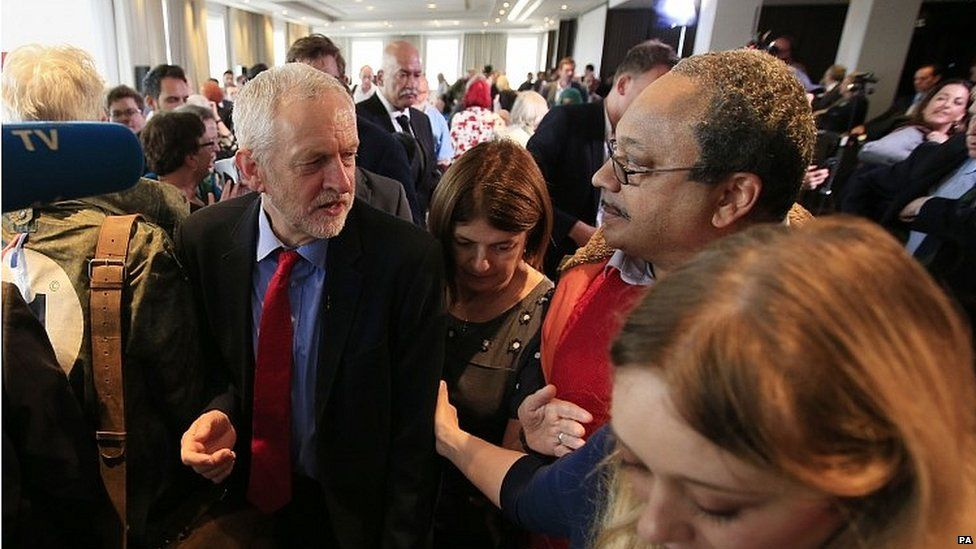 Jeremy Corbyn speaks to Marc Wadsworth at the launch of the Chakrabarti report in 2016