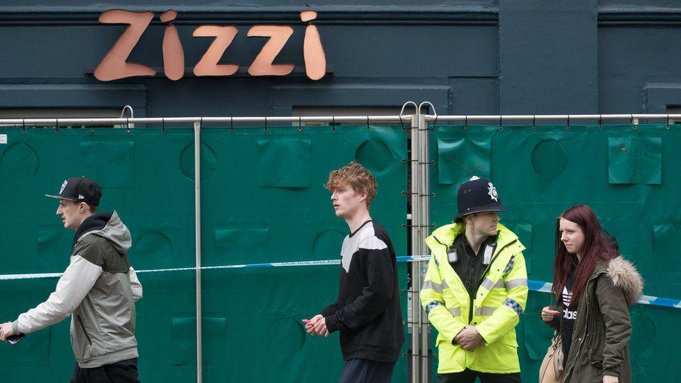 Police officers continue to stand guard outside the Zizzi restaurant in Salisbury, as police and members of the armed forces continue to investigate the suspected nerve agent attack on Russian double agent Sergei Skripa on March 12, 2018 in Wiltshire, England.