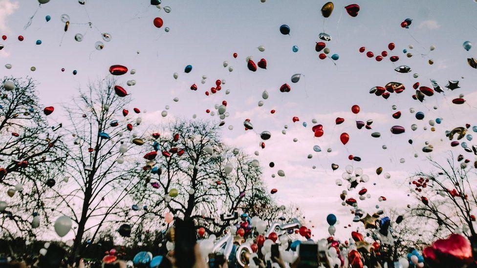 Balloons are released for Krept