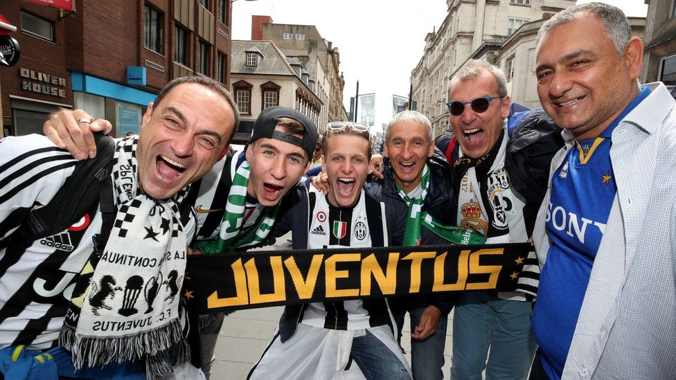 Juventus fans enjoy the atmosphere in Cardiff Bay