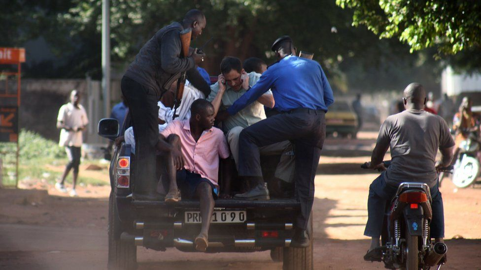 """Malian security forces prepare to transport hostages freed from the Radisson Blu hotel in Bamako on November 20, 2015. Gunmen went on a shooting rampage at the luxury hotel in Mali""""s capital Bamako, seizing 170 guests and staff in an ongoing hostage-taking that has left at least three people dead."""