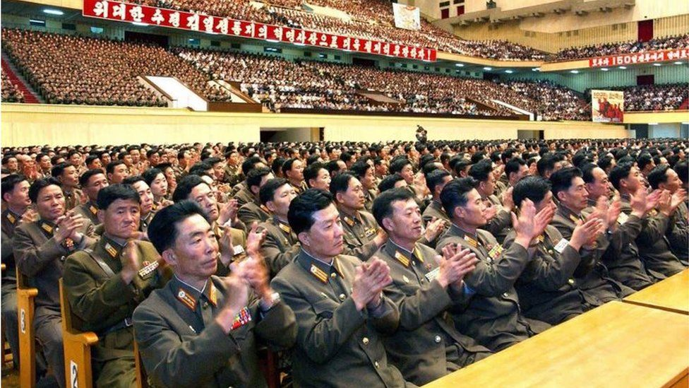 North Korean officials applaud news of a successful nuclear test (27 May 2009)