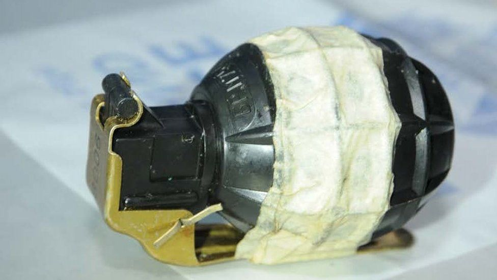 A grenade was among the cache of weapons discovered