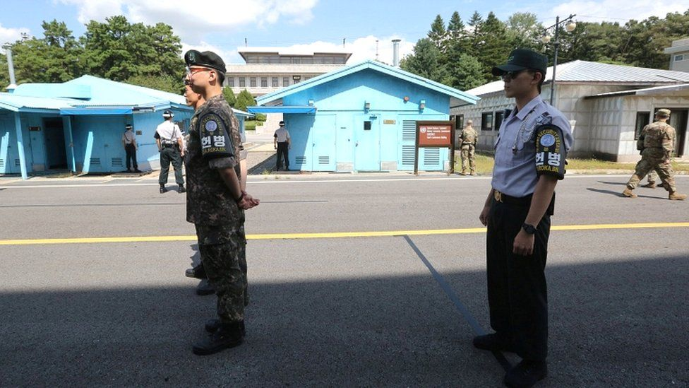 South Korean soldiers stand guard at the border village of Panmunjom in the Demilitarised Zone, South Korea, on 7 September 2018