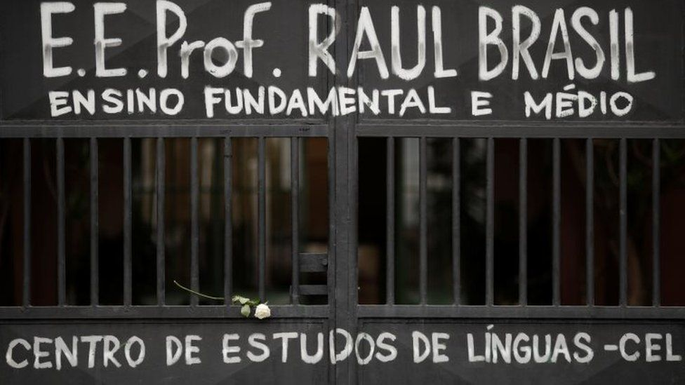 The entrance of Raul Brasil School is seen as students pay homage to victims killed in a shooting, in front of the school in Suzano, Brazil March 14, 2019.