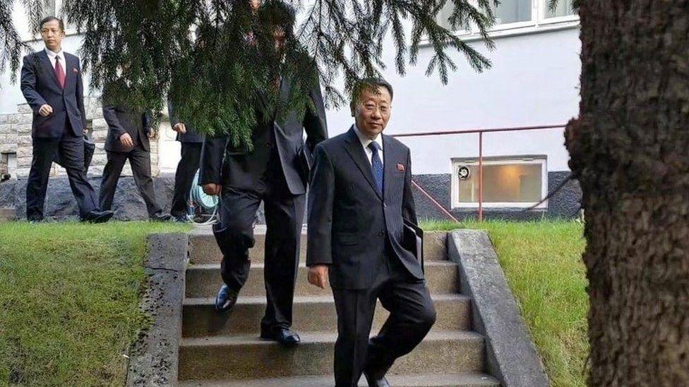 North Korean delegates, including top negotiator Kim Myong-gil, leaving the North Korean embassy in Stockholm - 5 October