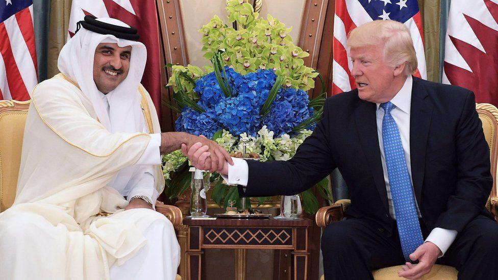 Qatar's Emir, Sheikh Tamim Al Thani, shakes hands with US President Donald Trump in Saudi Arabia (21 May 2017)