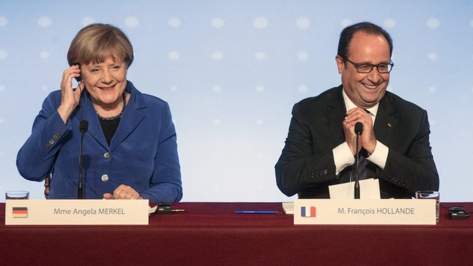 German Chancellor Angela Merkel and French President Francois Hollande hold a press conference following a summit on Ukraine in Paris, France, 2 October 2015