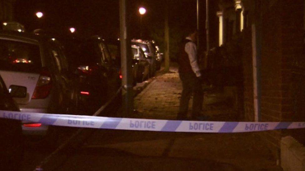 Police tape in road