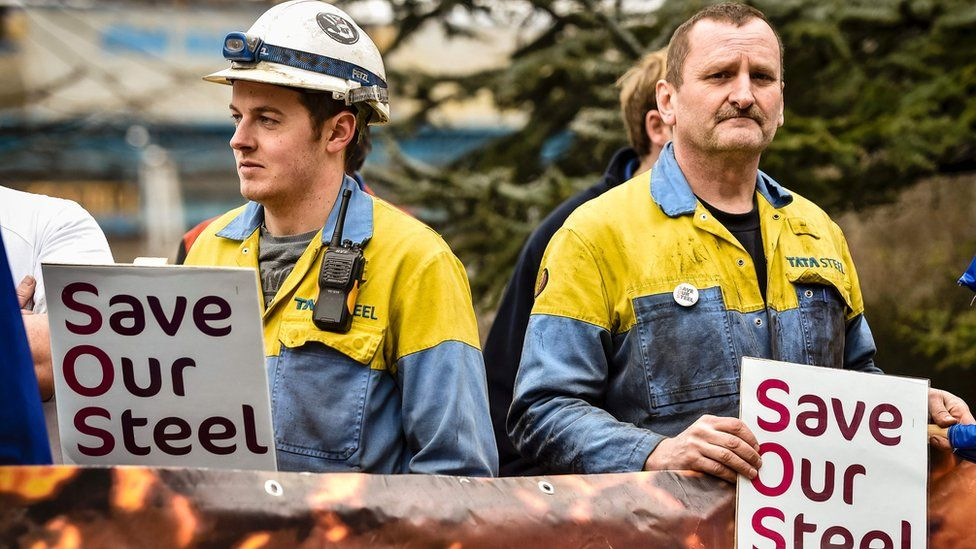 "Steel workers holding ""save our steel"" placards"