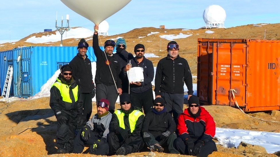 Members of the Bharati team launch a weather balloon.