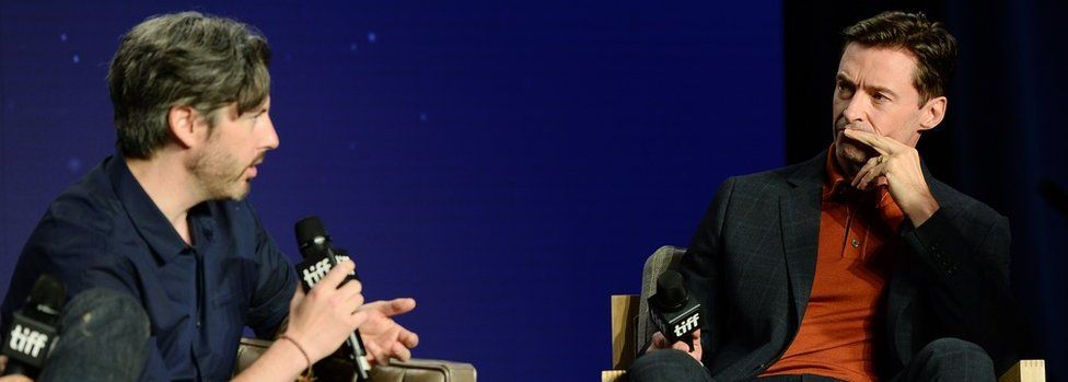 Hugh Jackman (r) listens to director Jason Reitman