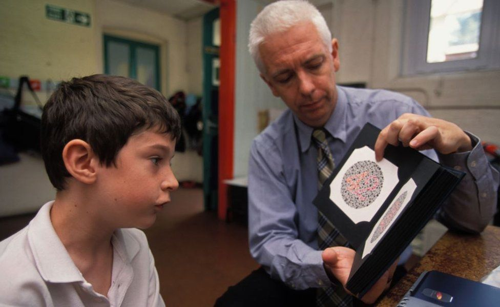 A schoolboy pictured during a colour vision test