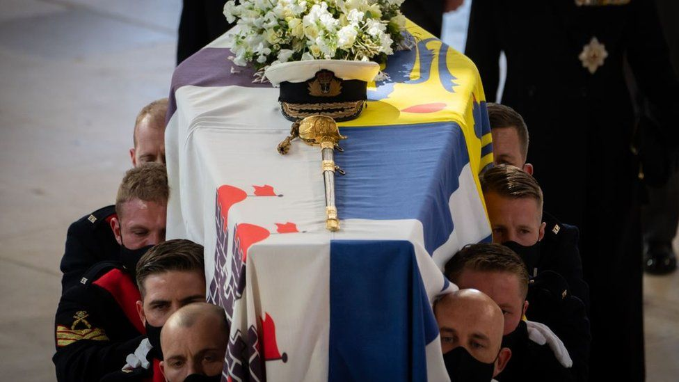 The Duke of Edinburgh's coffin draped in his Royal Standard is borne into St George's Chapel