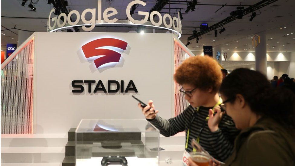 Attendees look at the new Stadia controller on display at the Google booth at the 2019 GDC Game Developers Conference on March 20, 2019 in San Francisco, California.