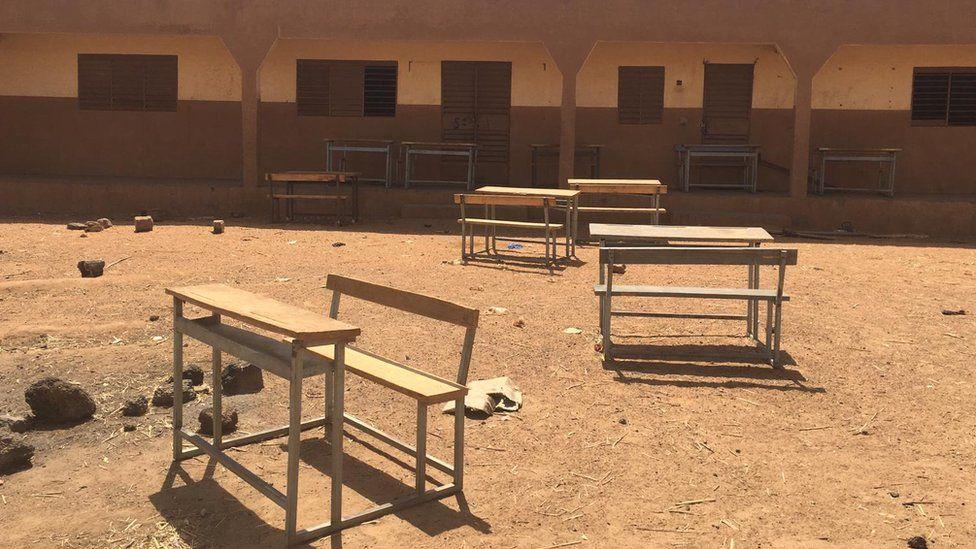 School desks outside an abandoned school in northern Burkina Faso
