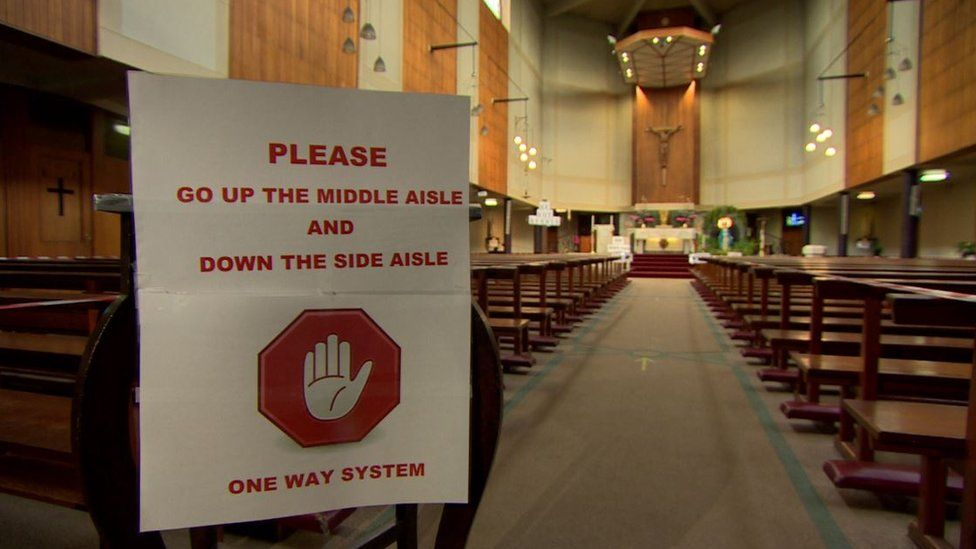 A sign directing people located inside a church