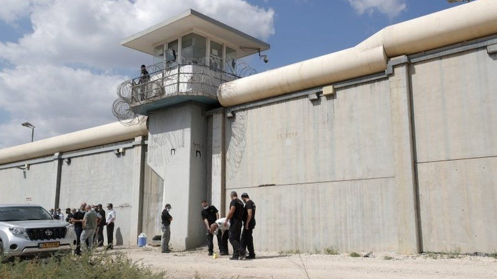 Israeli officials inspect the tunnel dug by the prisoners in a dirt road outside Gilboa prison's walls (6 September 2021)