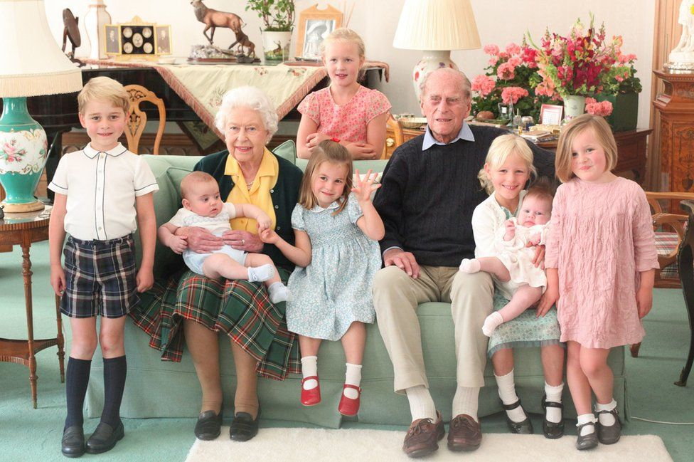 Pictured (left to right) Prince George, Prince Louis being held by Queen Elizabeth II, Savannah Phillips (standing at rear), Princess Charlotte, the Duke of Edinburgh, Isla Phillips holding Lena Tindall, and Mia Tindall.