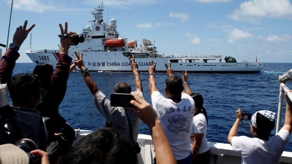Chinese Coast Guard vessel manoeuvres to block a Philippine government supply ship with members of media aboard at disputed Second Thomas Shoal in South China Sea