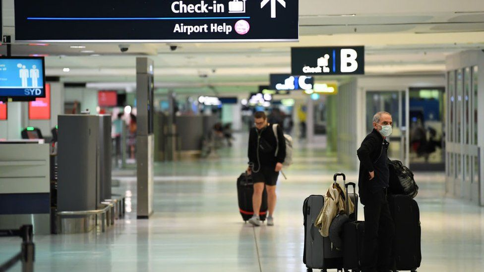 Travellers at Sydney Airport departure area on 20 March