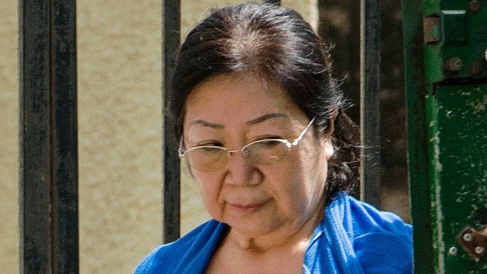 Yang Fenglan leaves the courthouse in Dar es Salaam on 12 April 2016