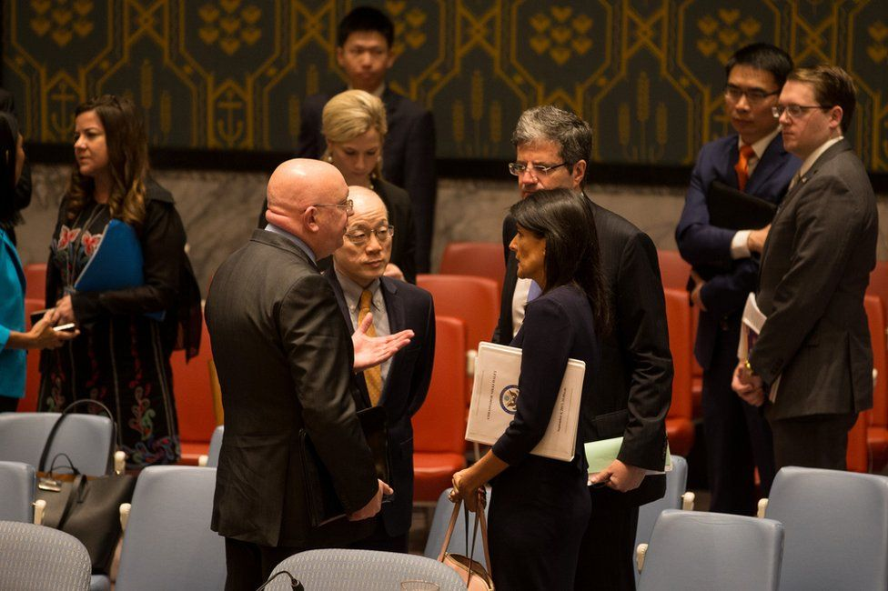 Russian ambassador to the UN Vasily Nebenzia (L) speaks to his China's Liu Jieyi (centre L), France's Francois Delattre (centre R) and Nikki Haley (R) of the US in New York, 4 September