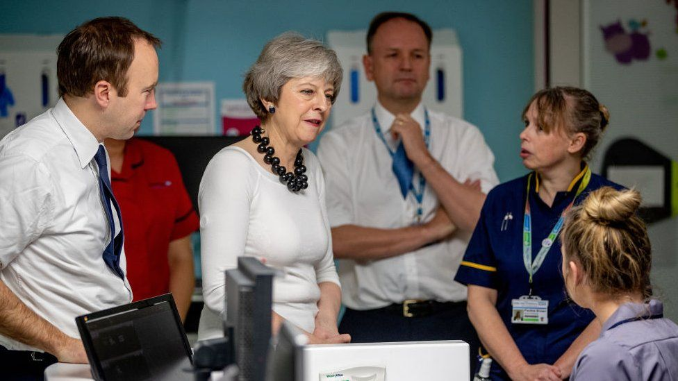 Theresa May in a hospital