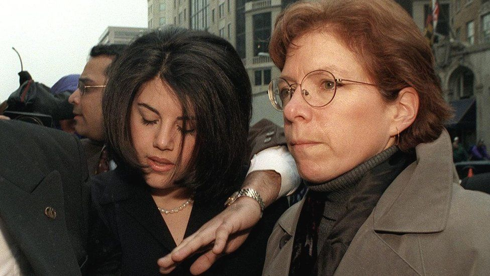 Monica Lewinsky being escorted through a media scrum in Washington in 1999