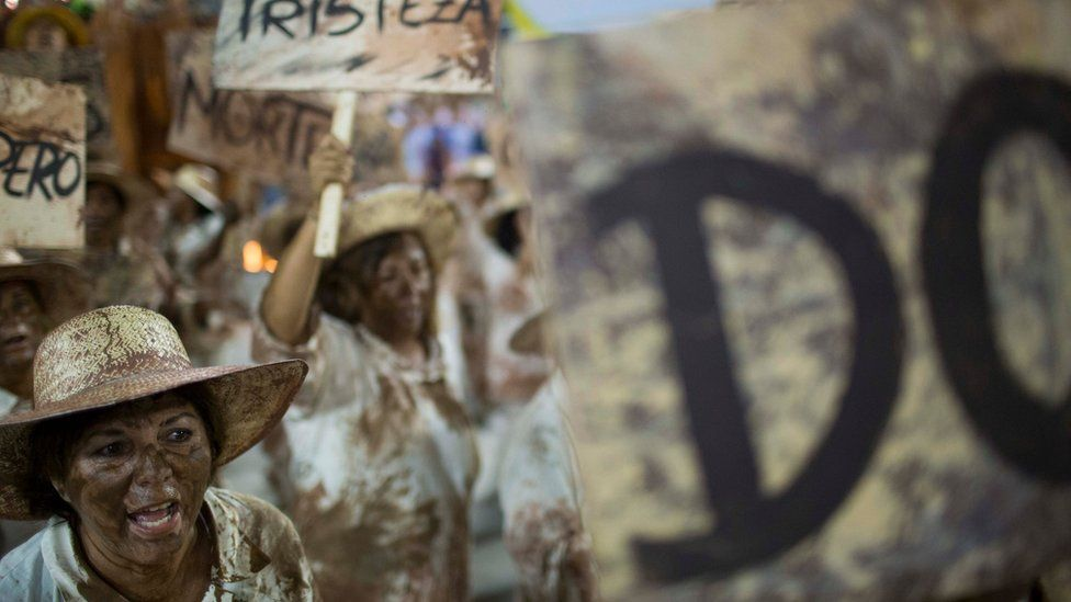 Rio carnival performers portrayed victims of the mud slide, holding up signs reading 'Death' and 'Sadness'