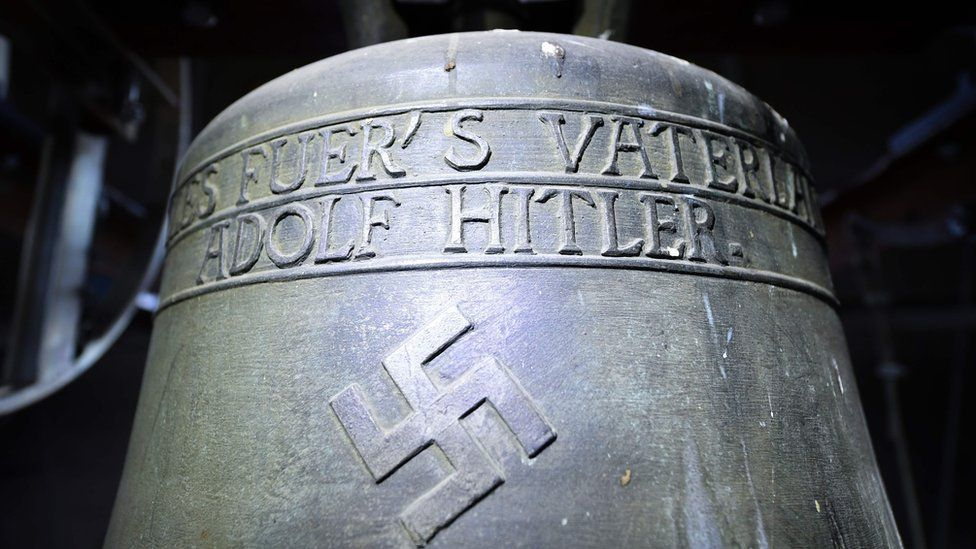 "Picture taken on May 19, 2017 shows a Nazi-era church bell that bears a swastika and the words ""All for the Fatherland Adolf Hitler"" (""Alles fuer""s Vaterland - Adolf Hitler"")."