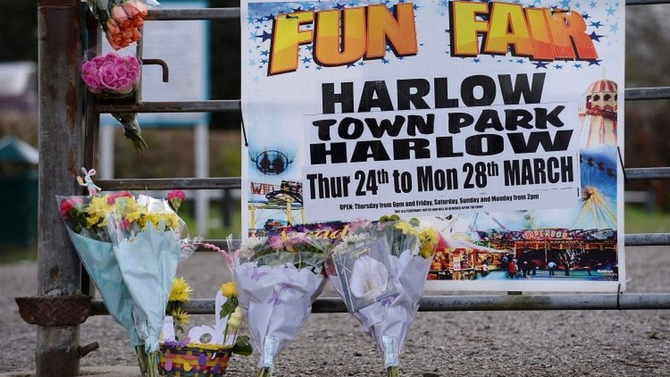 Flowers have been left by the gates of the park, where a fun fair was being held