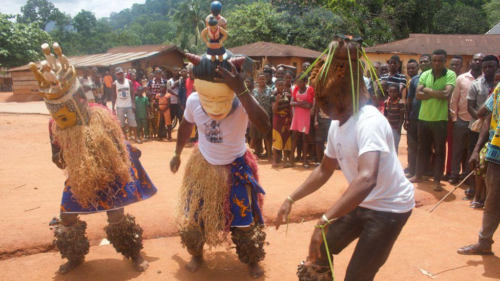 Masked men in Ubang performing in a masquerade