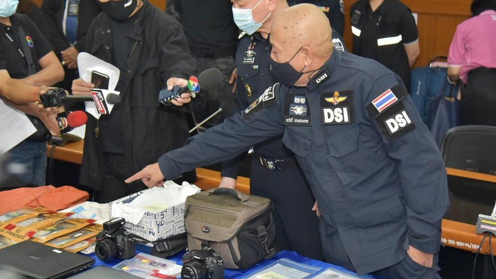 Thai police display items at a press conference