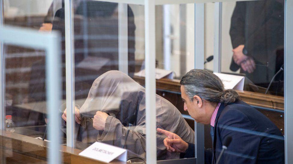 Opening of trial - Eyad al-Gharib in dock, April 2020