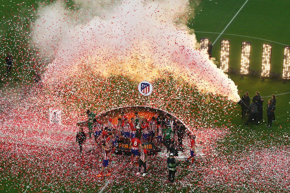 Atletico Madrid players lift The Europa League trophy after the UEFA Europa League Final between Olympique de Marseille and Club Atletico de Madrid at Stade de Lyon on 16 May 2018 in Lyon, France.