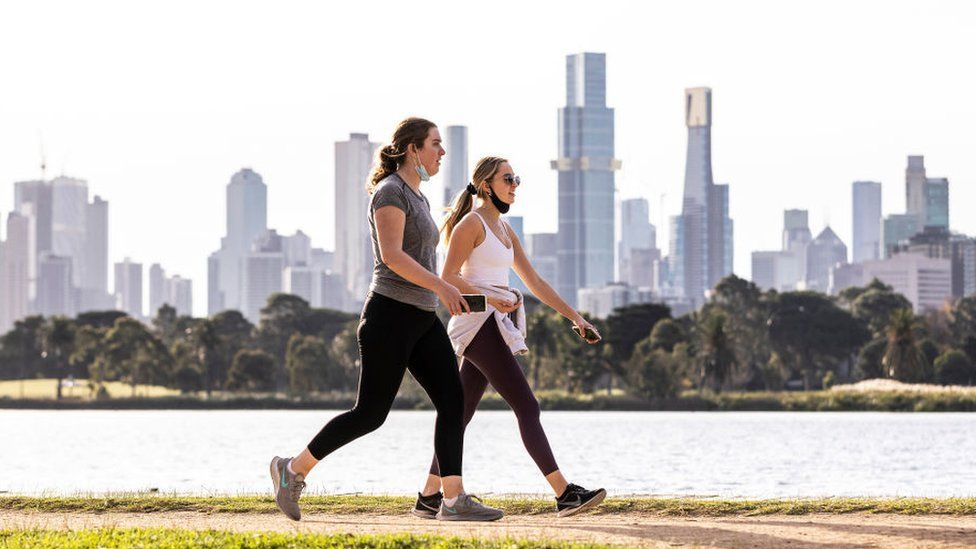 People are seen exercising at Albert Park Lake on 2 June 2021 in Melbourne, Australia