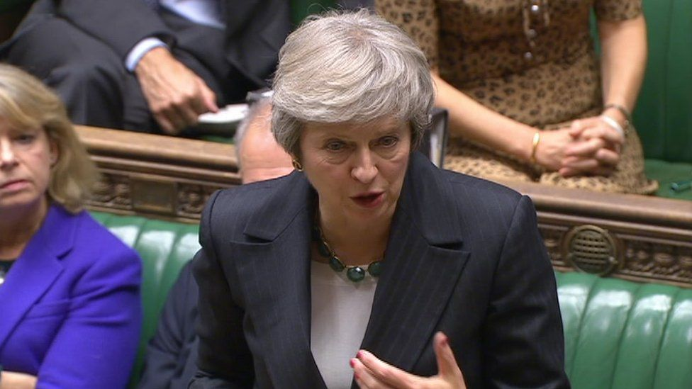 Theresa May defends the draft Brexit deal in the Commons