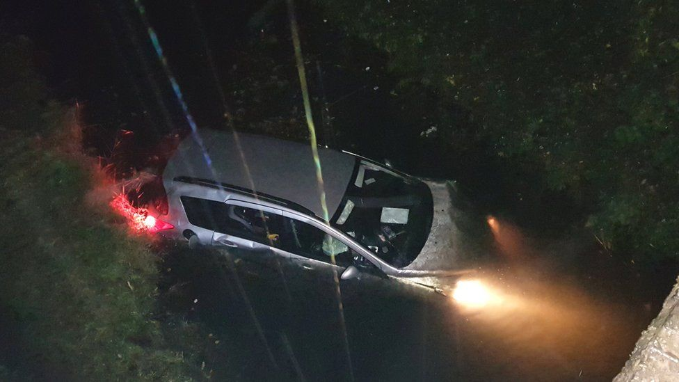 Car in canal at Neath Abbey, Neath Port Talbot