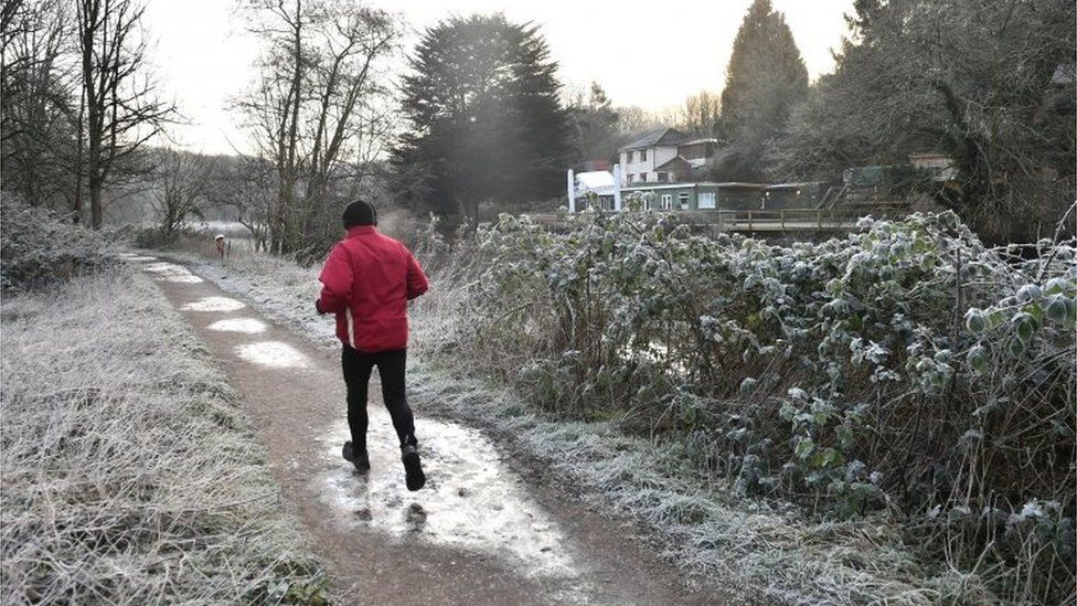 A jogger running by the River Avon in Bristol, pic 31 Jan