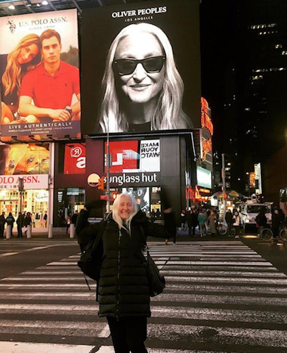 Gillean in Times Square with her billboard in the background