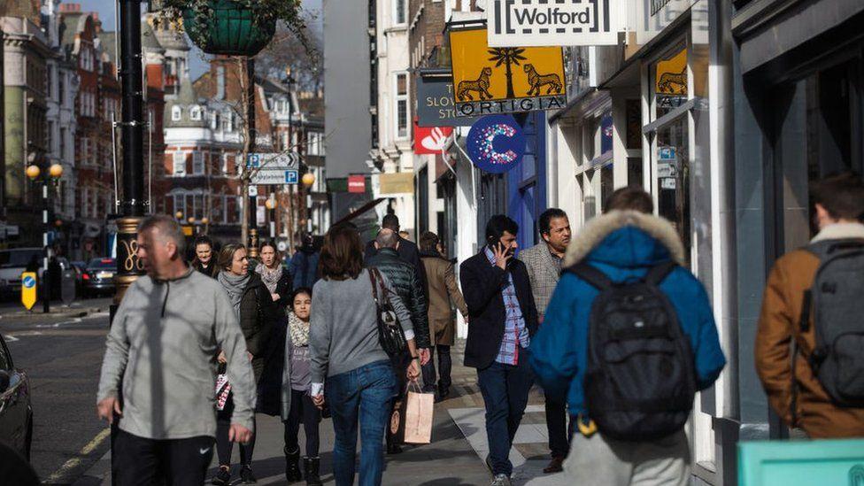 People walk down Marylebone High Street on February 16, 2017 in London, England
