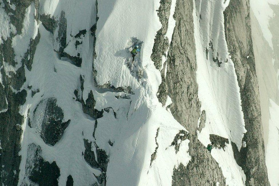 Jon Bracey climbing up the mountain
