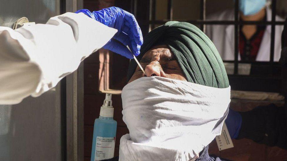 Man in Amritsar having nasal swab taken