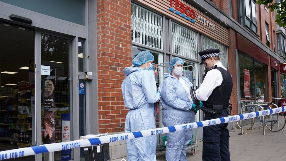 Police outside Tesco Express in Fulham after the alleged incidents