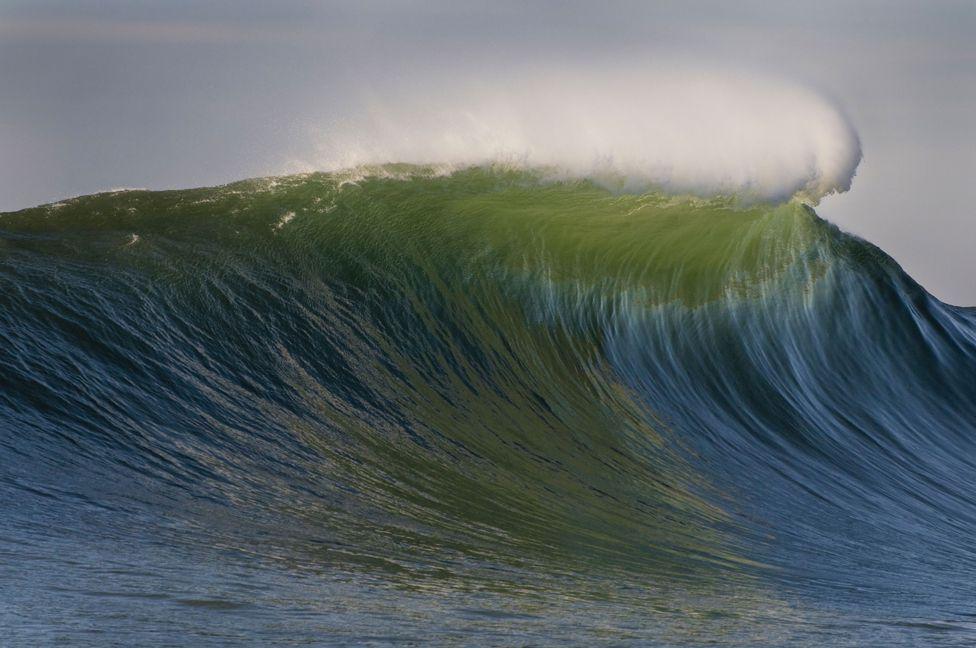 Breaking waves at the surf beach at Mavericks Monterey Bay California USA