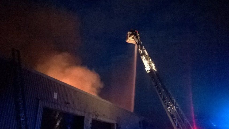 Firefighters tackle the fire at Culvert Place, Battersea