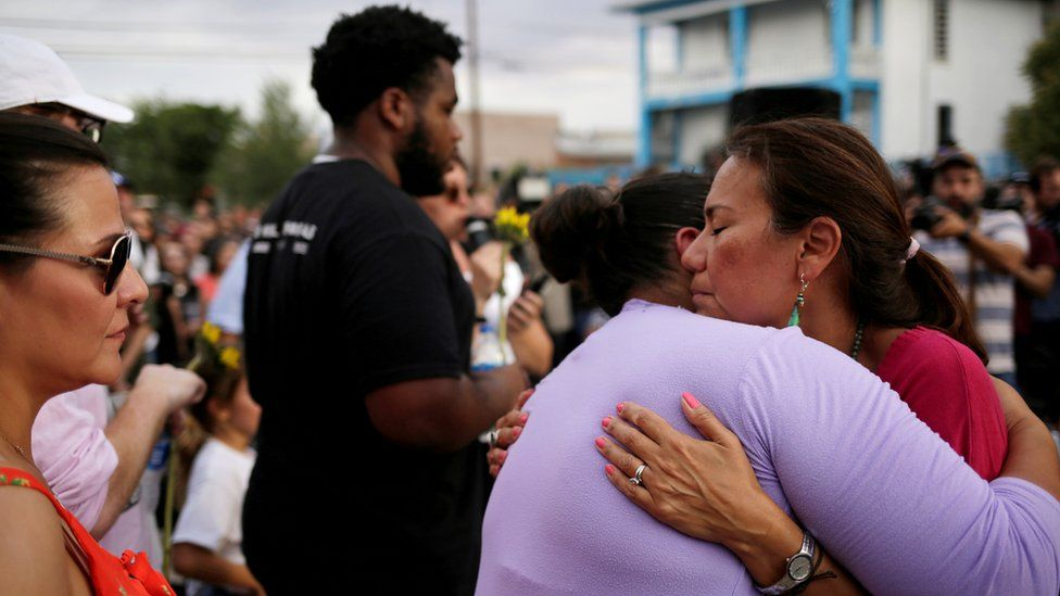 People take part in a rally against hate a day after a mass shooting at a Walmart store, in El Paso