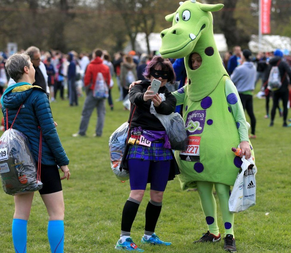 Fancy dress competitors take a selfie before the race